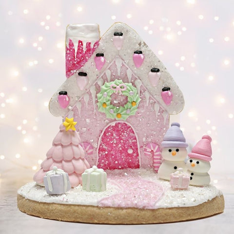 Pink Christmas Cookie Gingerbread House by Bakery Bling with Pink Edible Glitter Sugar Sprinkles and Pastel Baking for the Holidays Snowman Christmas Tree
