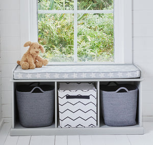 Grey storage bench with storage cubes and baskets