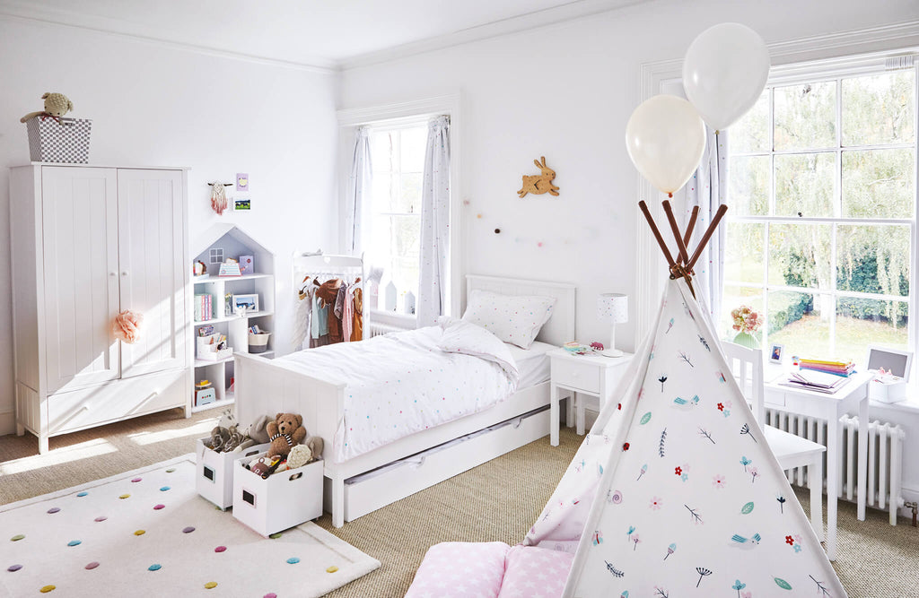 white children's bedroom with pastel accessories