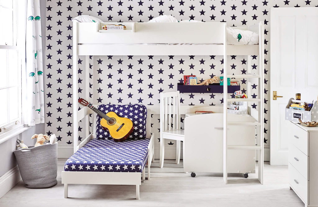 Ivory high sleeper bed in navy star bedroom