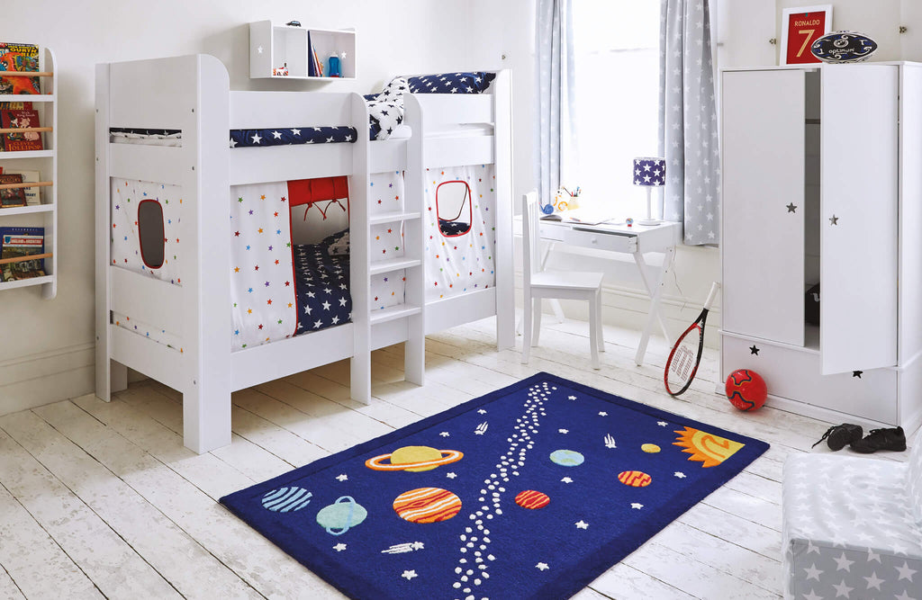 space themed bedroom with rainbow stardust accessories