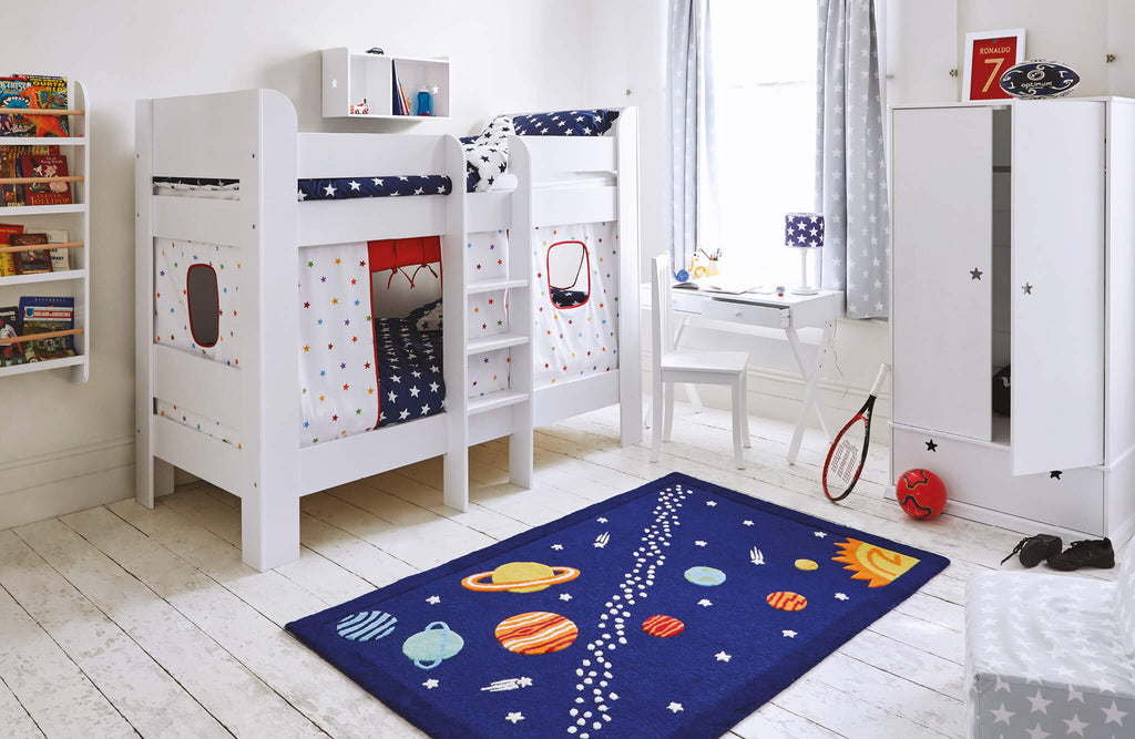 Planets themed bedroom with white furniture
