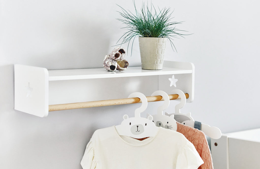 white and wood clothes rail with animal hangers