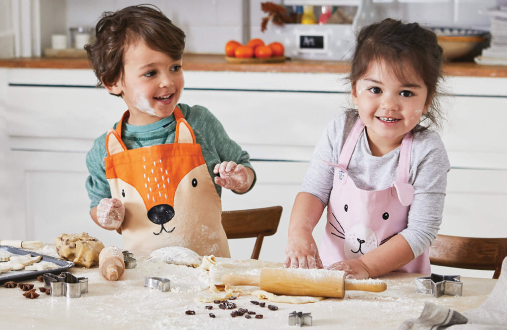Kids wearing Mr Fox and Miss Bunny aprons