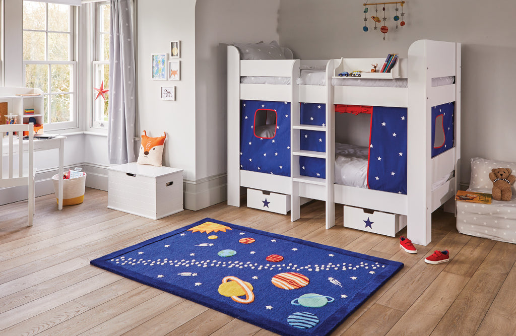 kids' bedroom with white bunk bed and planets rug