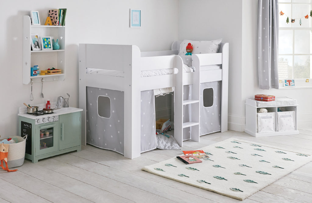 Kids' mid sleeper bed with grey stardust curtains