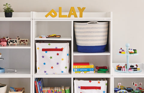 white playroom shelving & rainbow coloured storage baskets