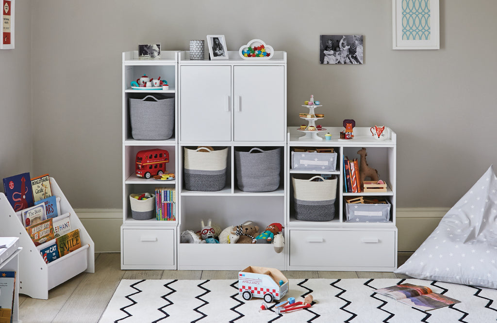 White playroom storage and zigzag rug