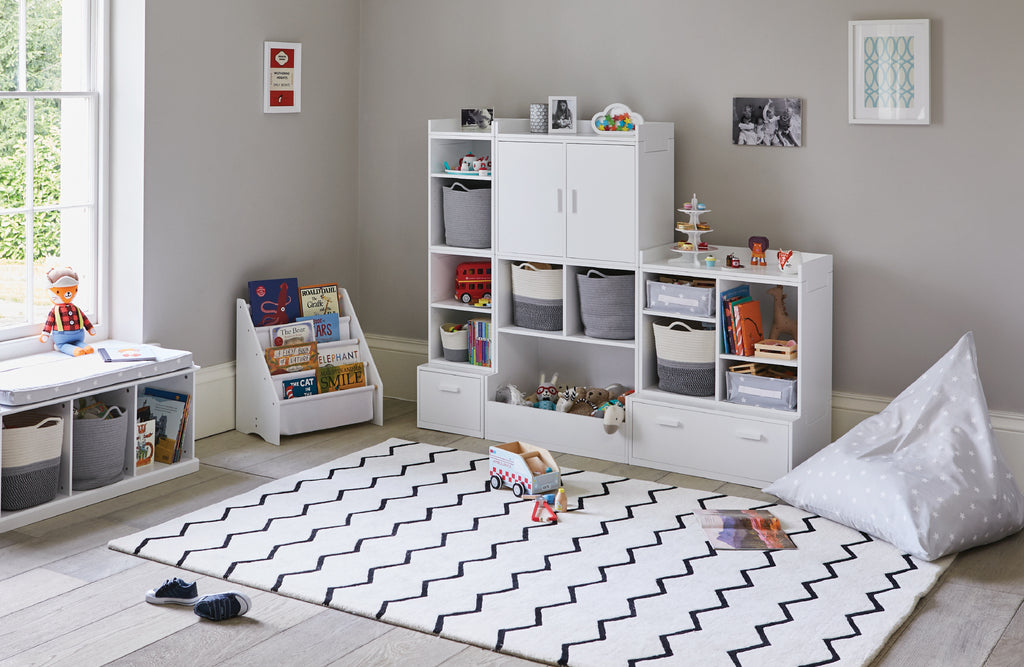 Zigzag rug playroom and white modular toy storage