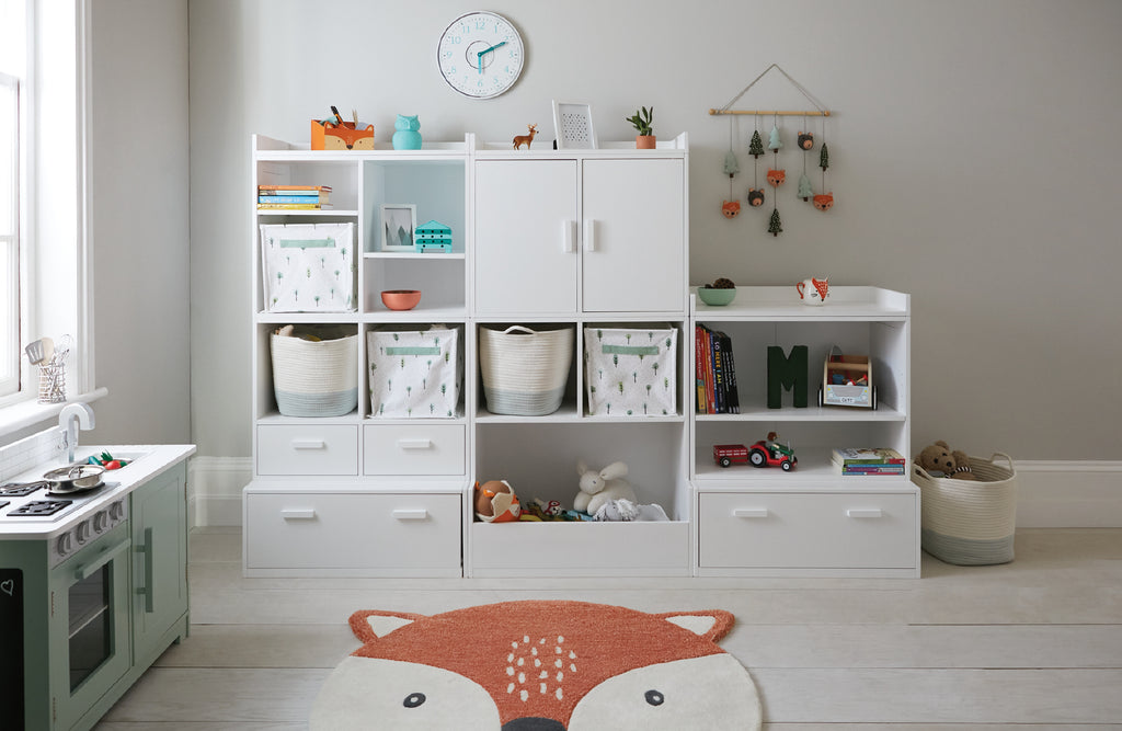 white playroom storage in woodland themed room