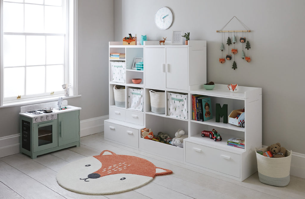 White playroom storage and fox rug