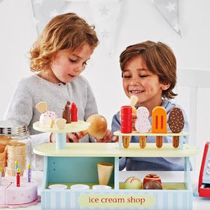 Young girl and boy role playing with Lolly and Scoop Ice Cream Shop
