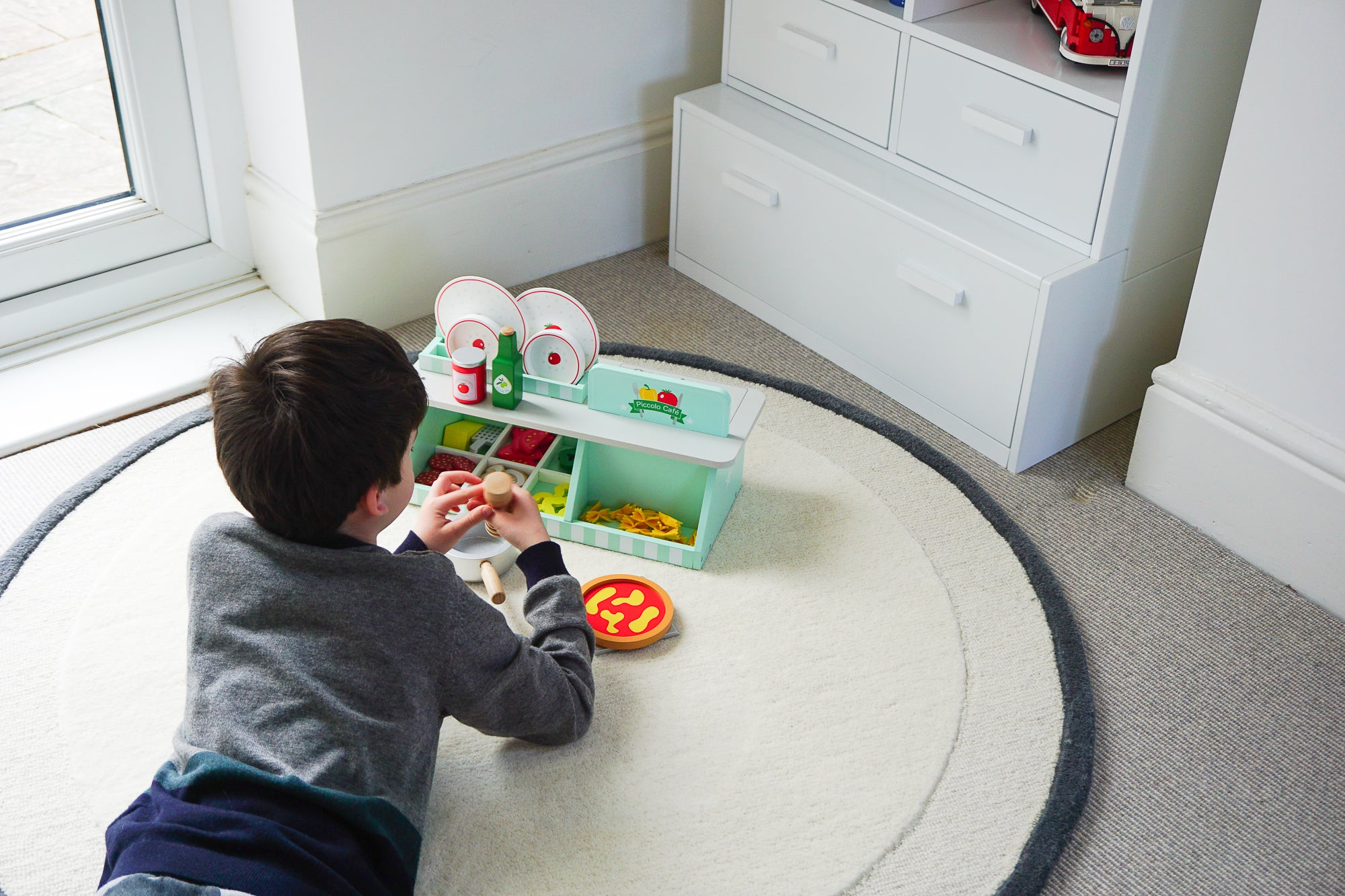 Turn your living room into a shared space with versatile toy storage