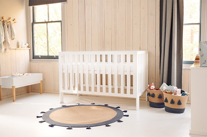 white cot bed in rustic nursery