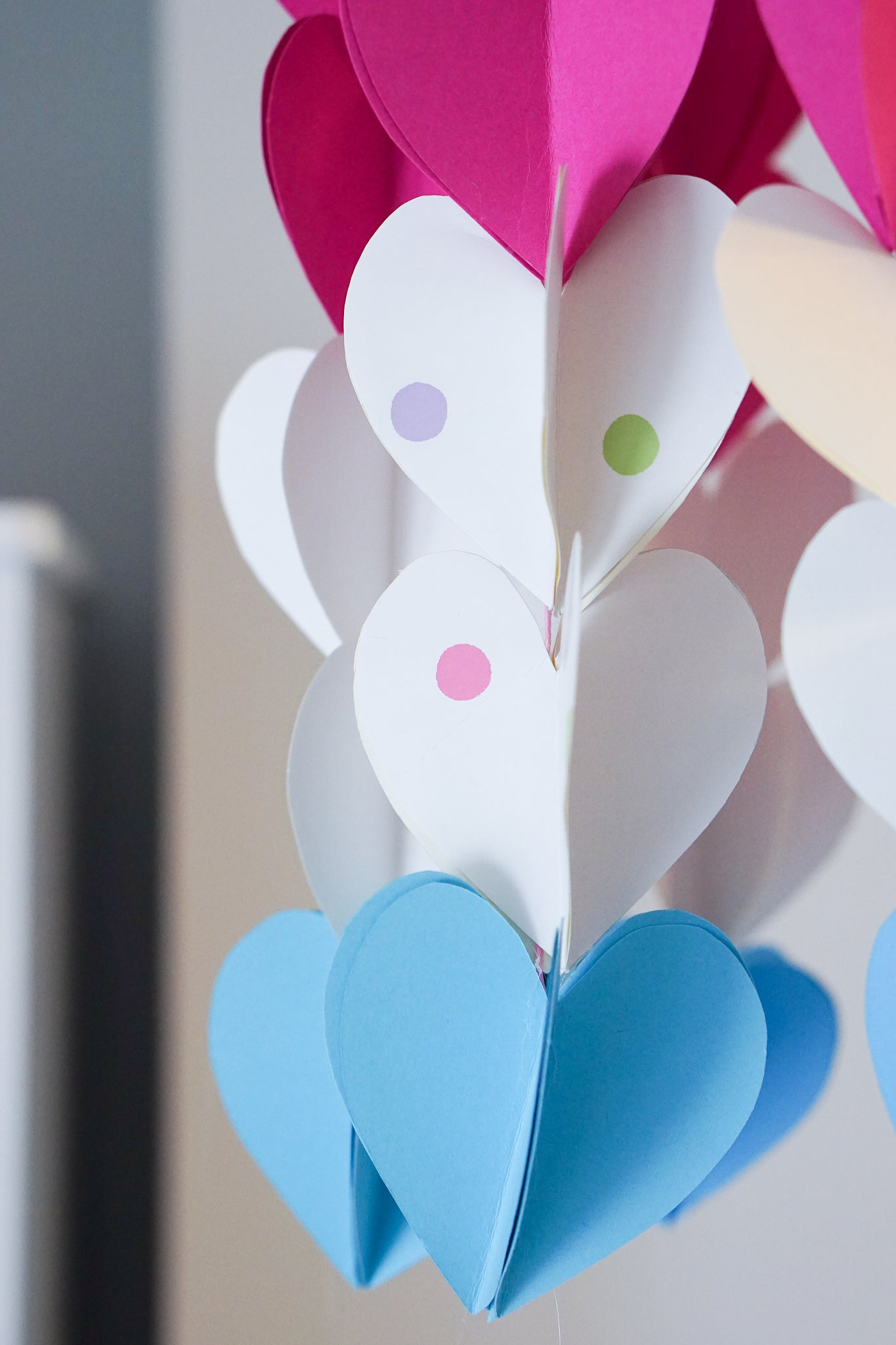 Make a heart-themed mobile from leftover children's wallpaper