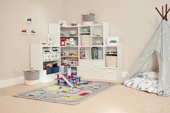 White corner toy storage in transport-themed playroom