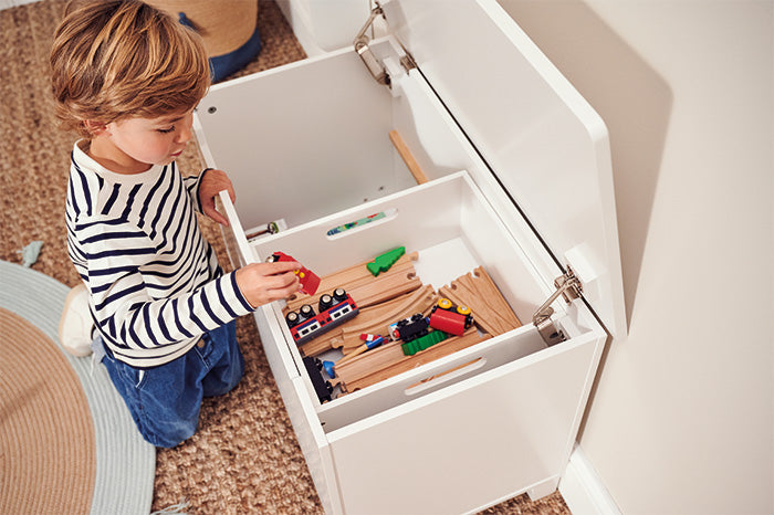 White toy box with sliding internal tray for small toys