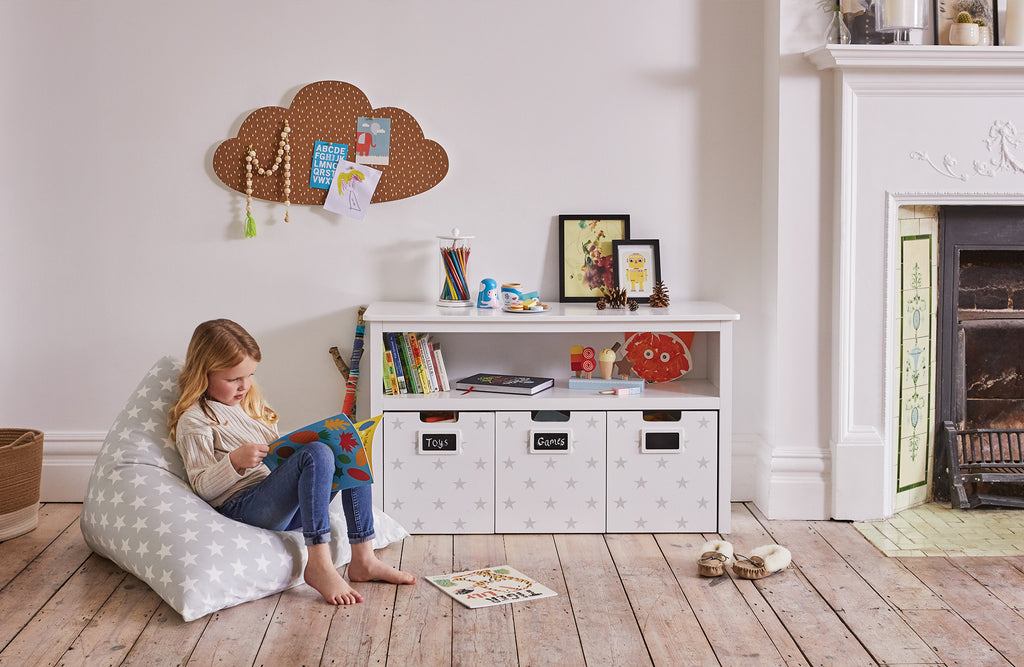 Grey star easy reach storage in a playroom
