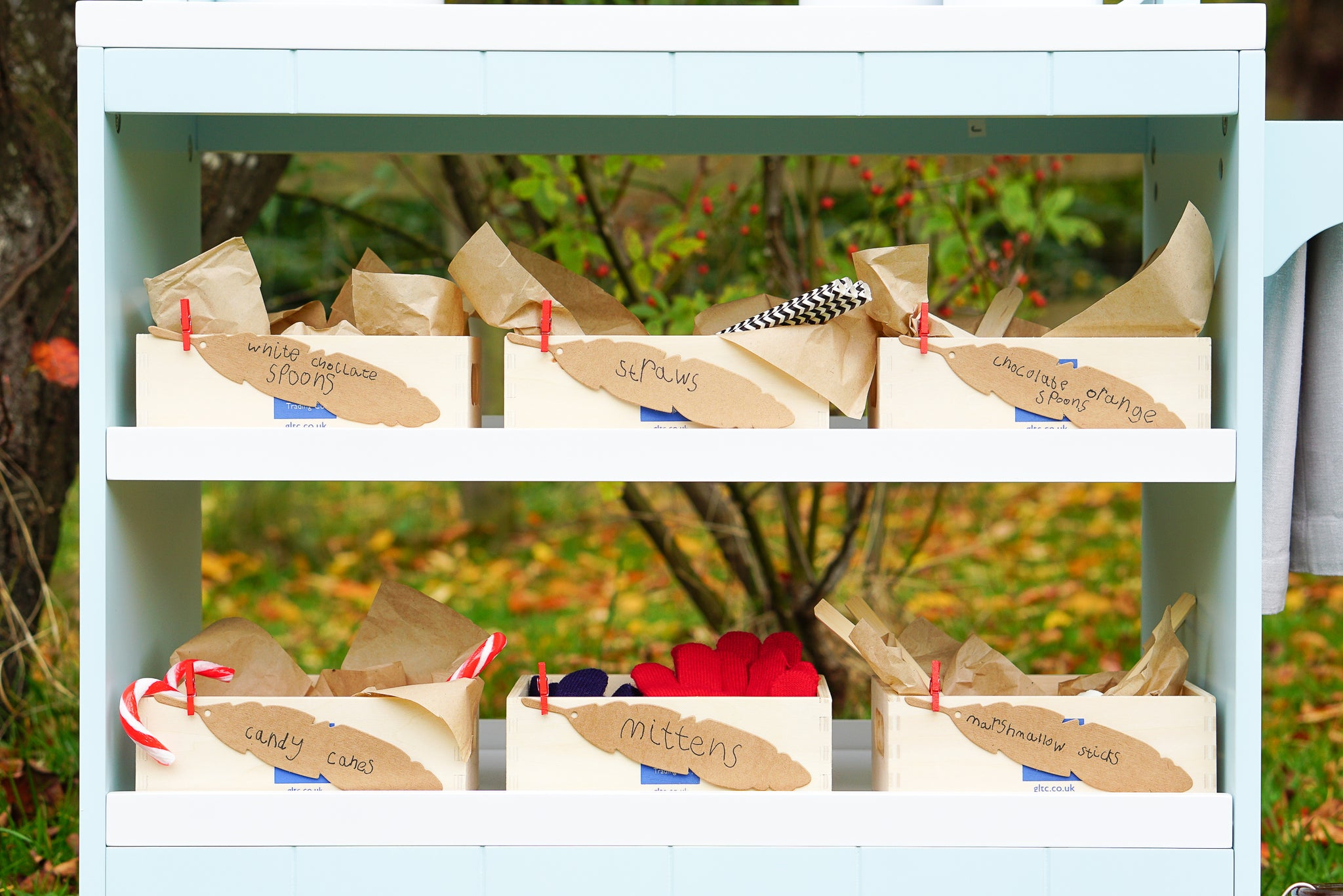 Set up a children's outdoor hot chocolate bar for hand warming role play fun