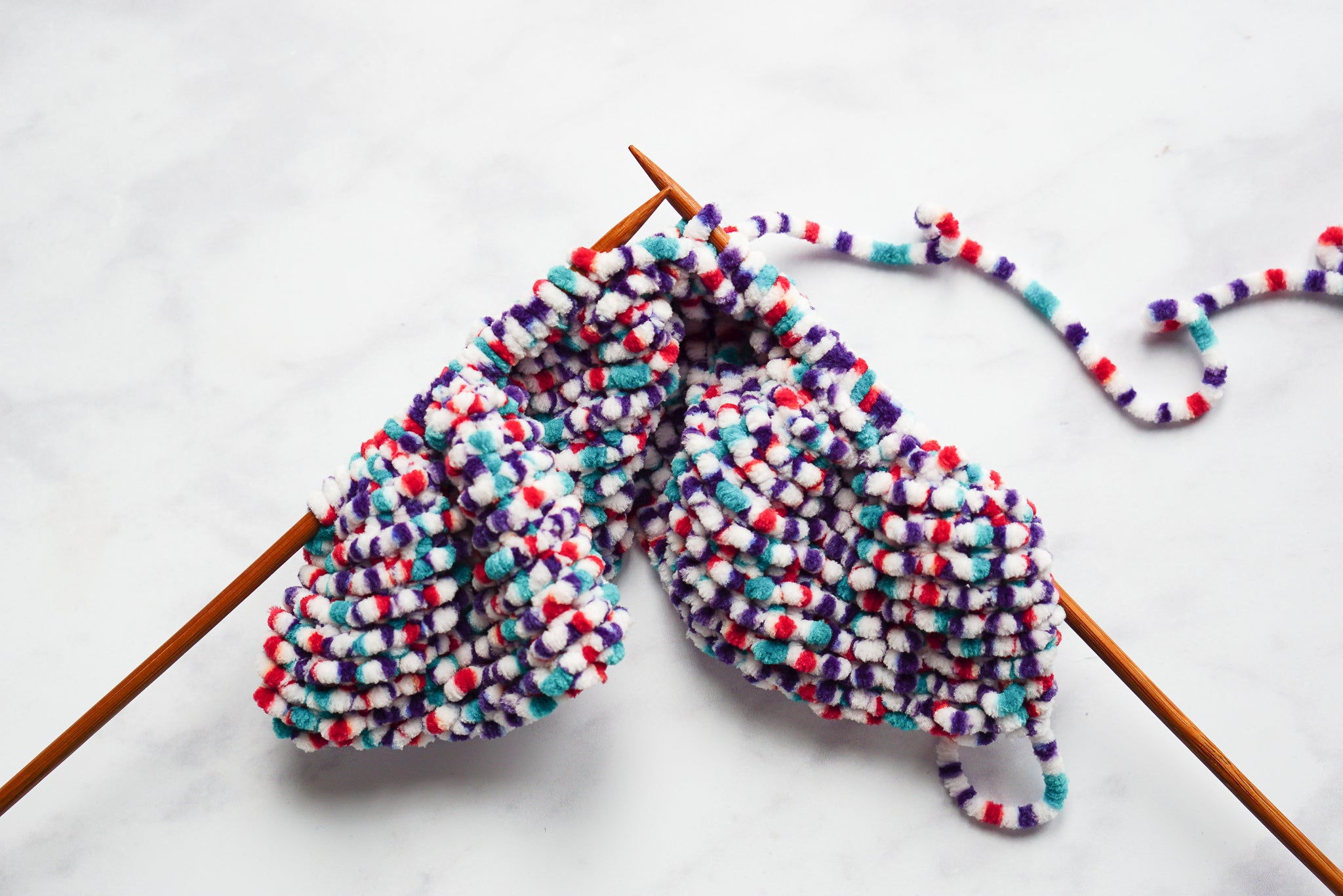 Knit a snuggly blanket for your child's doll's pram
