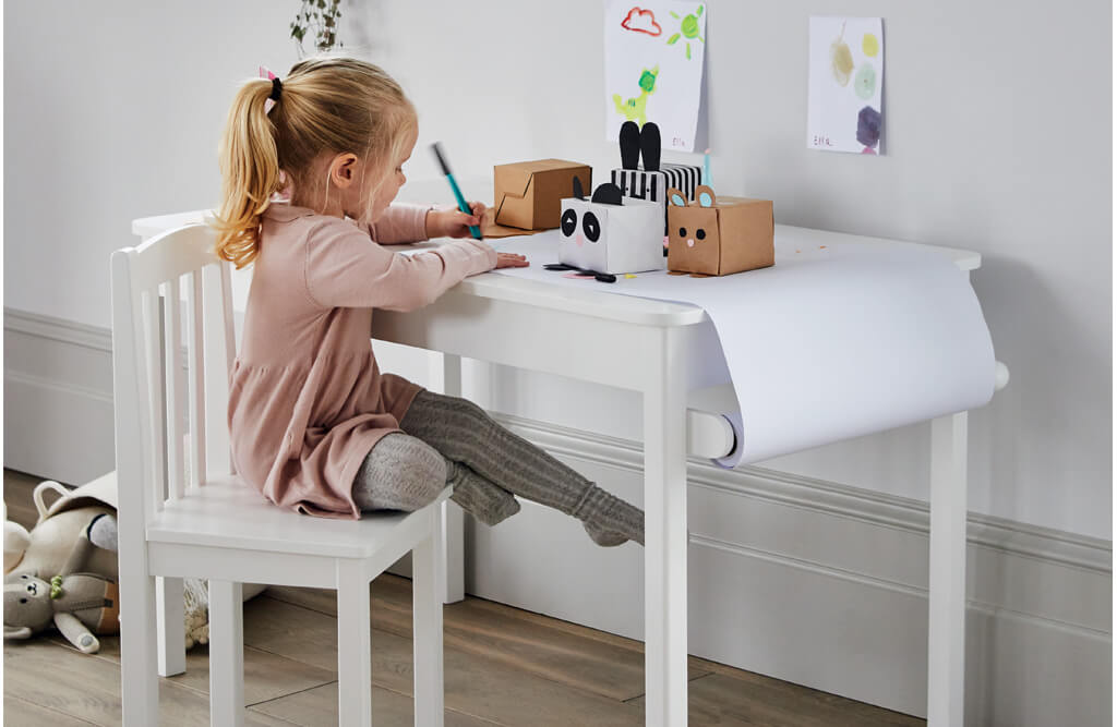 Young girl sat at Growing Activity Table