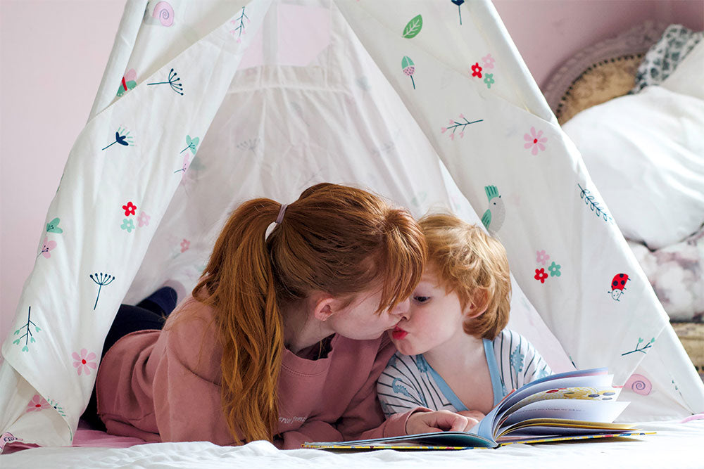 Mother and son inside play teepee