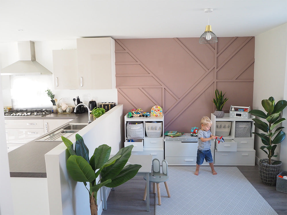 Alba playroom storage and pink feature wall