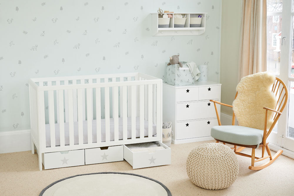 Neutral nursery with white cot bed