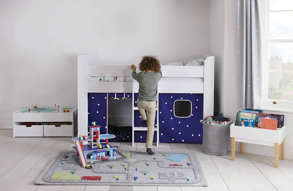 white mid sleeper bed, on the road children's rug