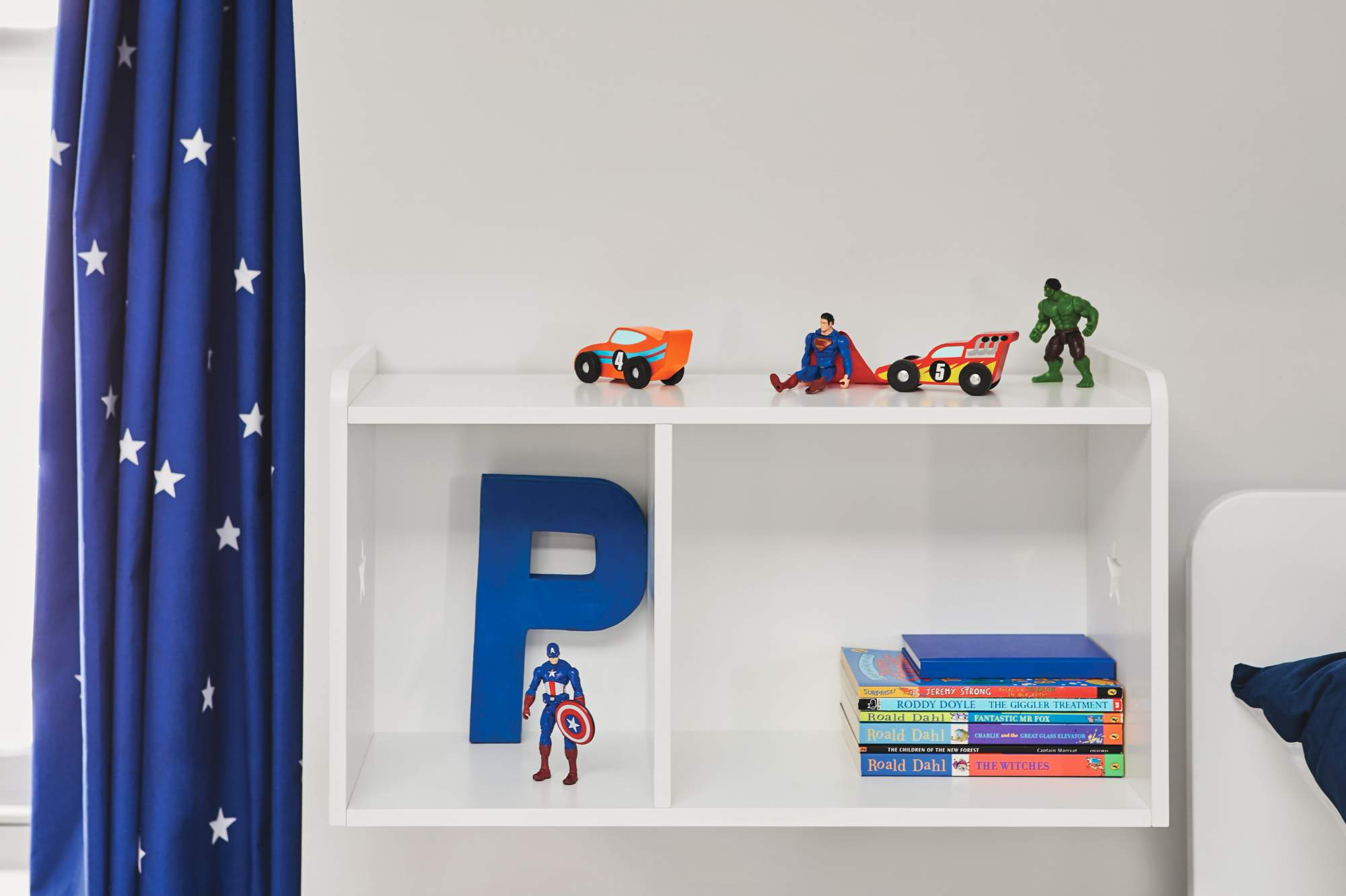 Wall shelves that double up as children's bedside tables