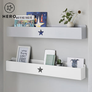 Grey and white wooden book ledges with a star
