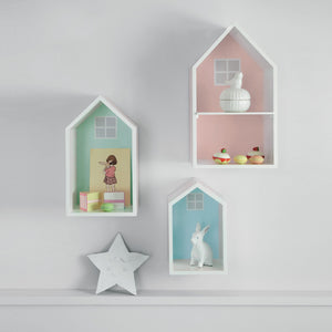 Pastel coloured wooden wall shelves and a star