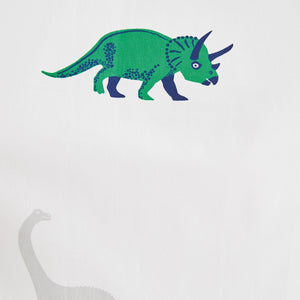 White curtain print with green dinosaur