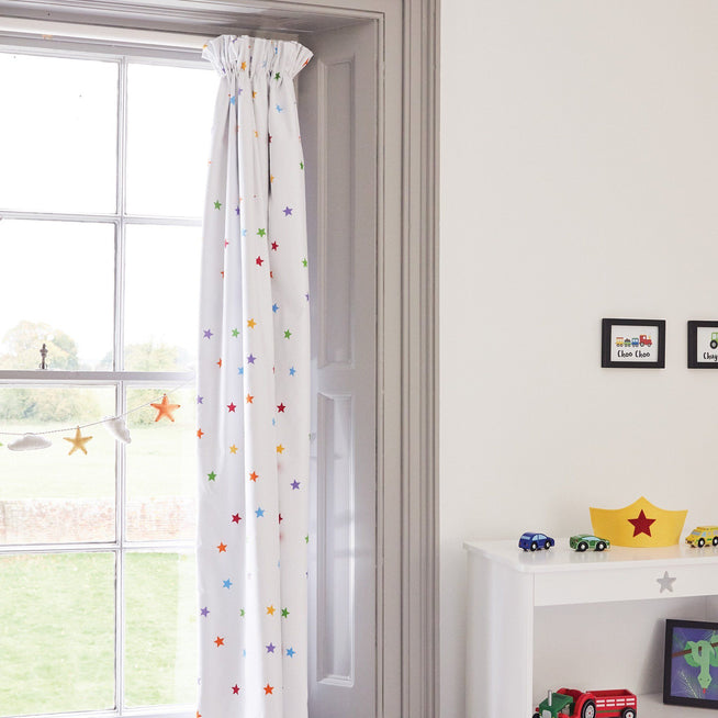 White curtain print with rainbow stars