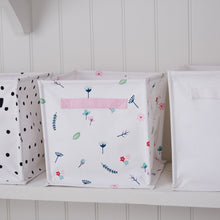 Canvas storage cube in white with floral details.
