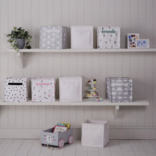 Canvas storage cubes in various designs and a wooden book cart.