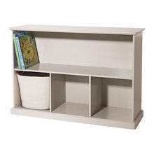 Storage shelf unit in stone with various wooden toys, children's books and storage cubes.