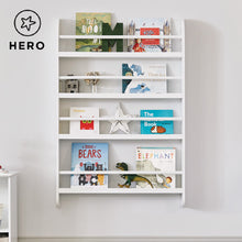 Greenaway gallery bookcase in white with many children's books and a cuddly toy.