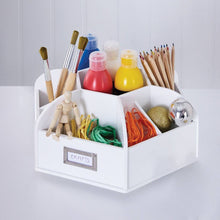 white desk organiser filled with painting supplies