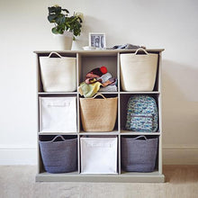 Nine cube storage unit in stone, with storage cubes and baskets.