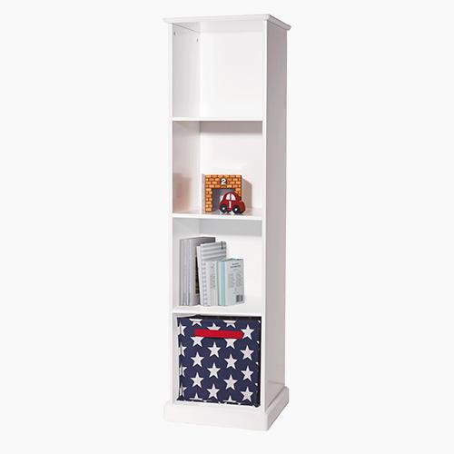 Abbeville tall four cube storage unit in white with a navy & white star storage cube and children's books.