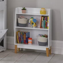 Potter bookcase in white with children's books and wooden toys.