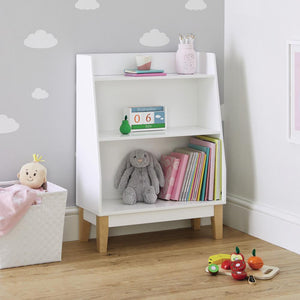 Potter bookcase in white with children's books and a navy star rug.