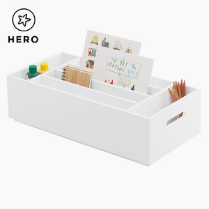 Rackham storage tray in white with children's books.
