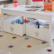 white storage drawers with grey star under activity table