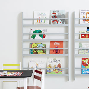 Greenaway gallery bookcase in cloud grey with children's books and a Russian doll.
