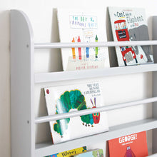 Greenaway gallery bookcase in cloud grey with many children's books and a red bus book cart.