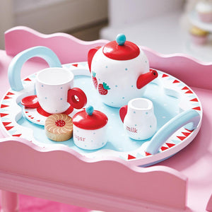 Wooden berry tea set and treats.