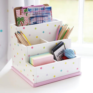 Children's desk tidy with five compartments in white with multi-coloured spots.