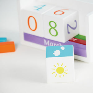 Wooden perpetual calendar for children with day, number, month and weather pieces.